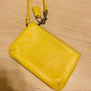 COACH yellow leather wristlet